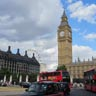 Big Ben, a black cab, and a red double-decker bus in Parliament Square