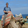 Twitter avatar; photo of me riding on a camel